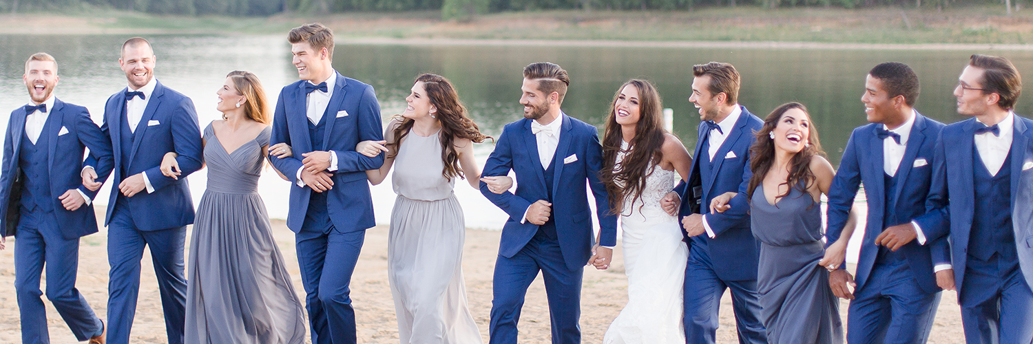 Large wedding party in matching rented tuxedos